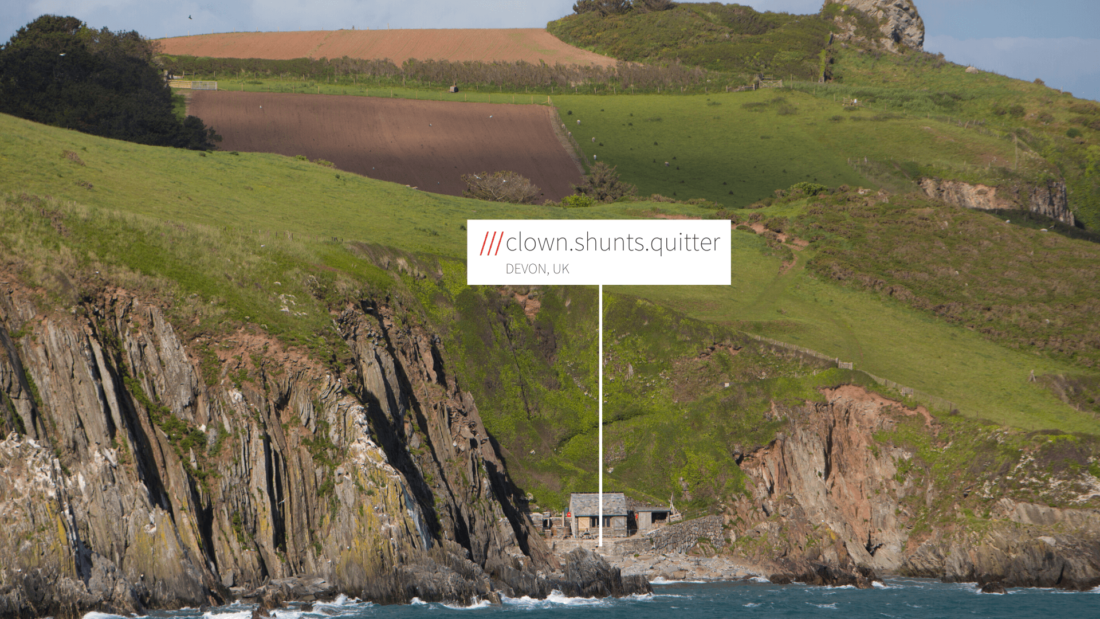 View of countryside and edge of cliff with small house at 3 word address Clown.Shunts.Quitter