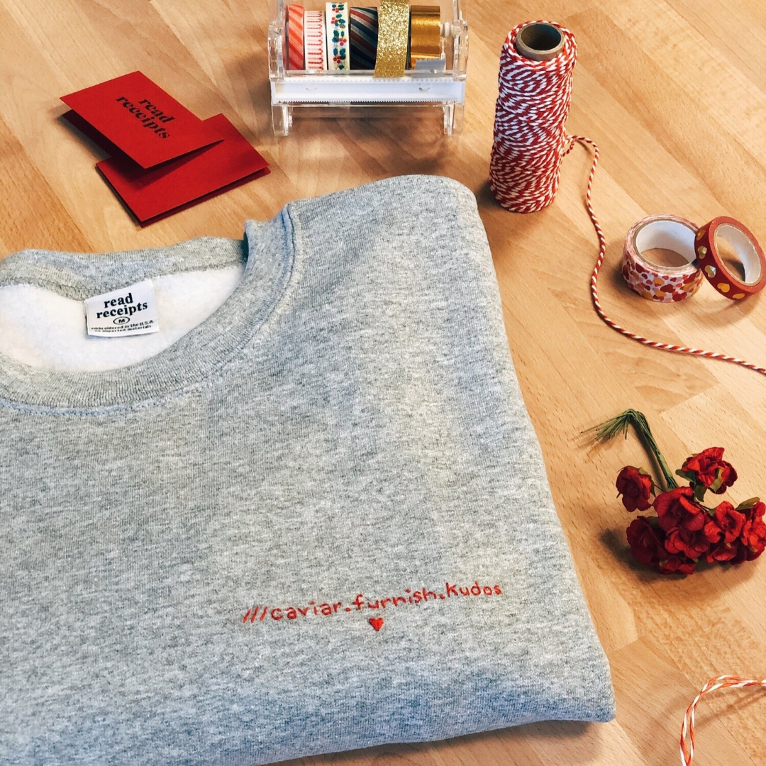 Personalised sweatshirt with a what 3 words address sewn on