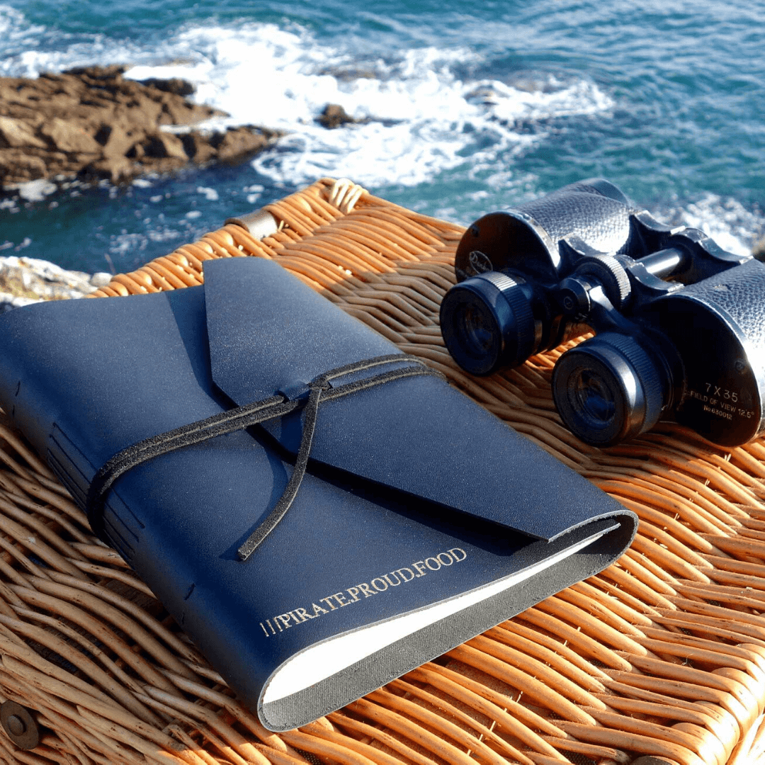personalised travel journal and binoculars with a what 3 words address imprinted on