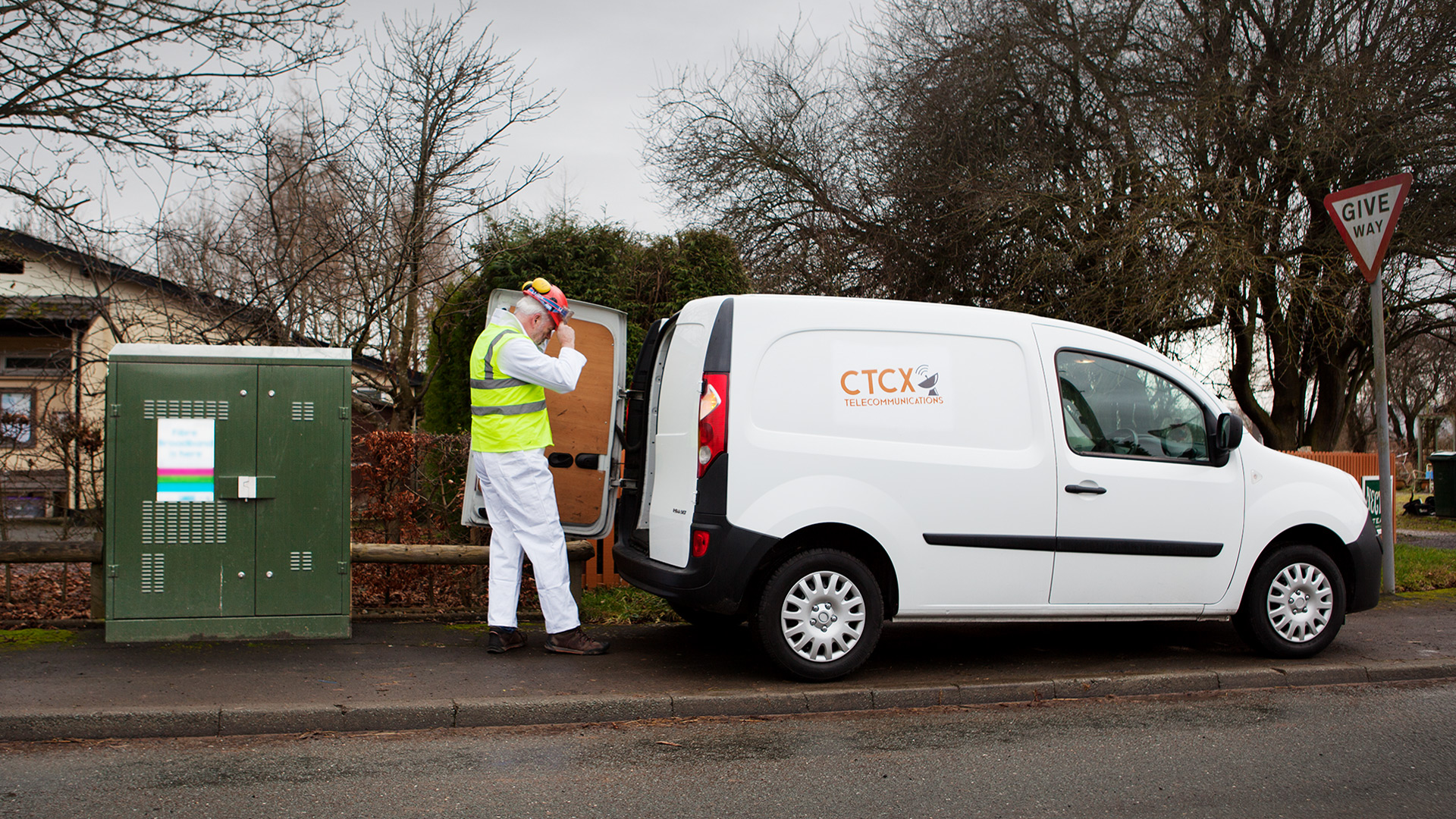 National Grid worker by van preparing for work