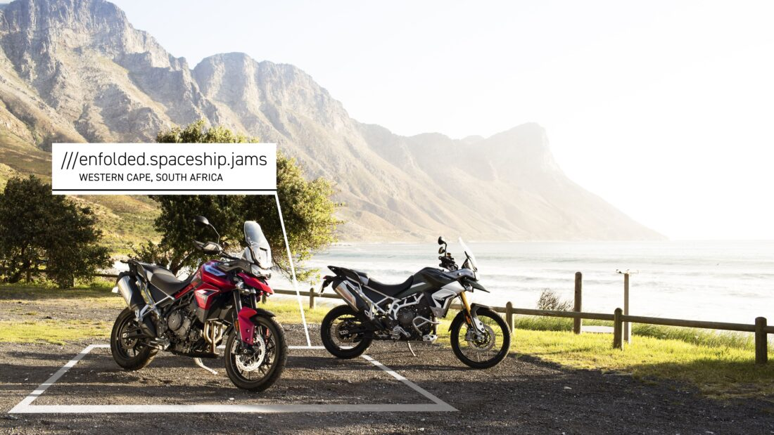 two motorbikes parked up by sea at Western Cape, South Africa at 3 word address ///enfolded.spaceship.jams