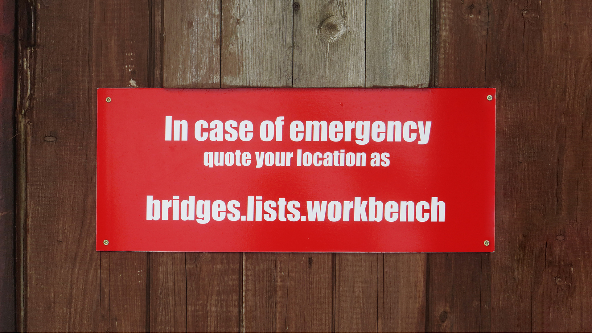 In case of emergency sign with 3 word address attached to fence
