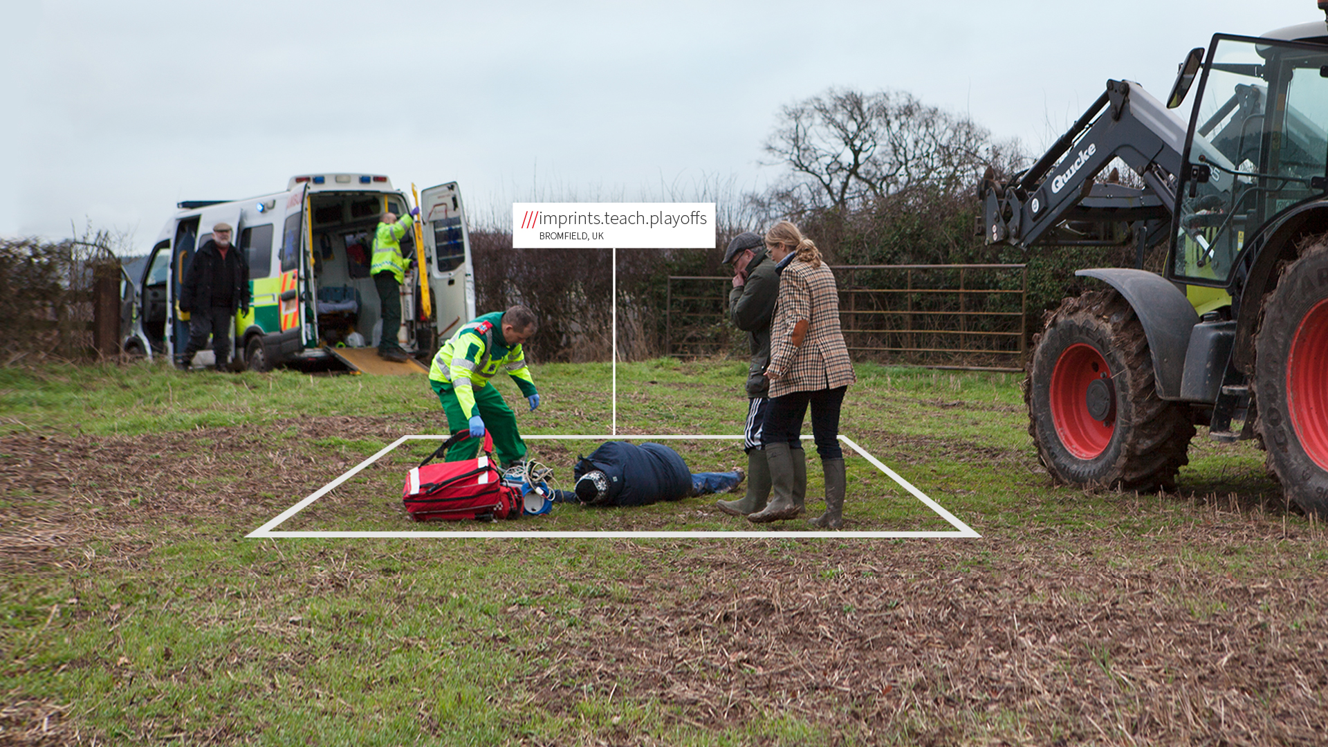 Ambulance team with unconscious man in field