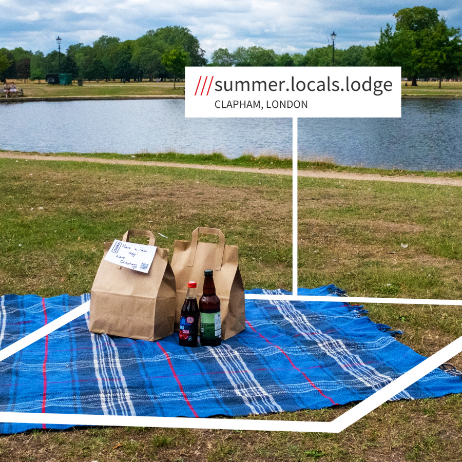 paper bags on a picnic blanket with what3words address summer.locals.lodge