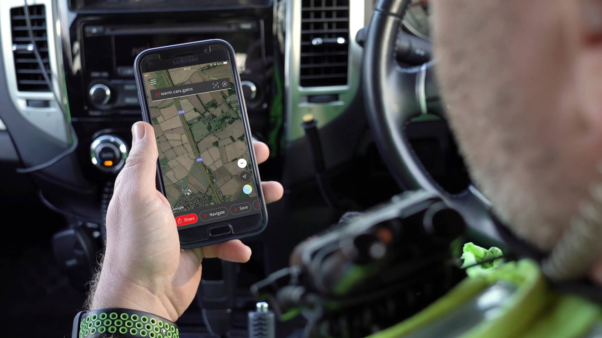 Police officer looking at what3words address on phone