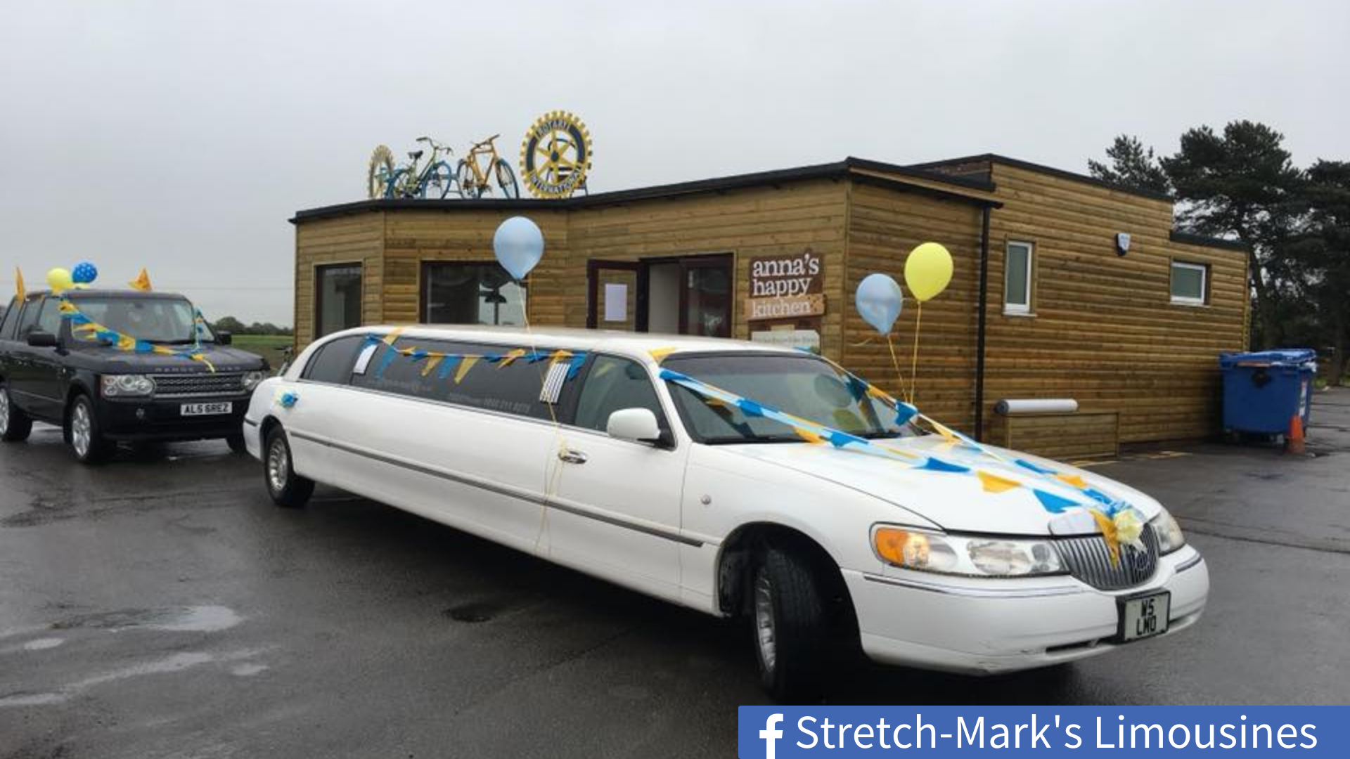 Limousine with bunting and flags