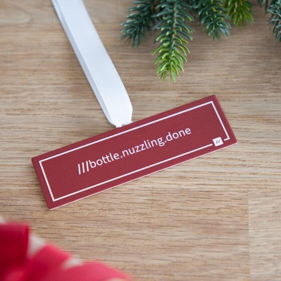 No Ordinary Gift hanging what3words sign for Christmas