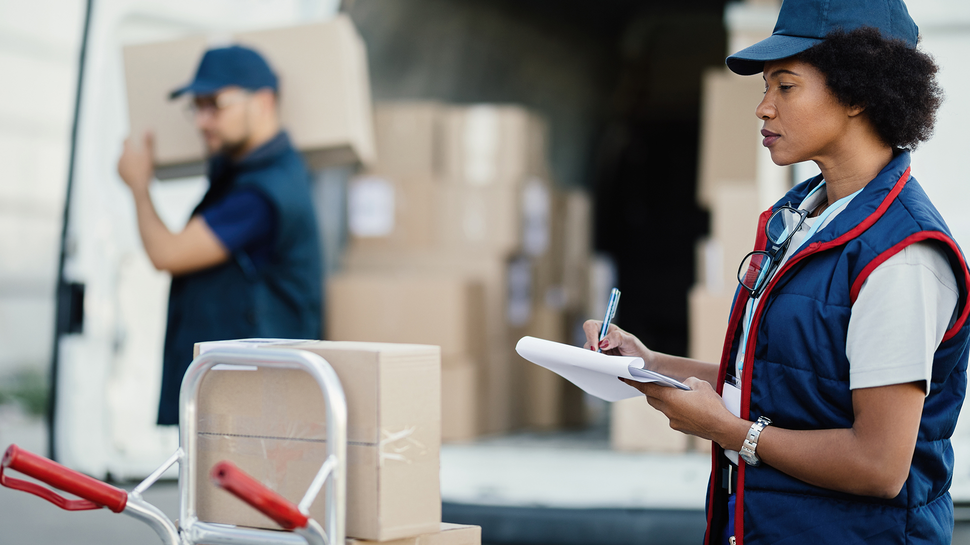 Logistics workers busy in warehouse