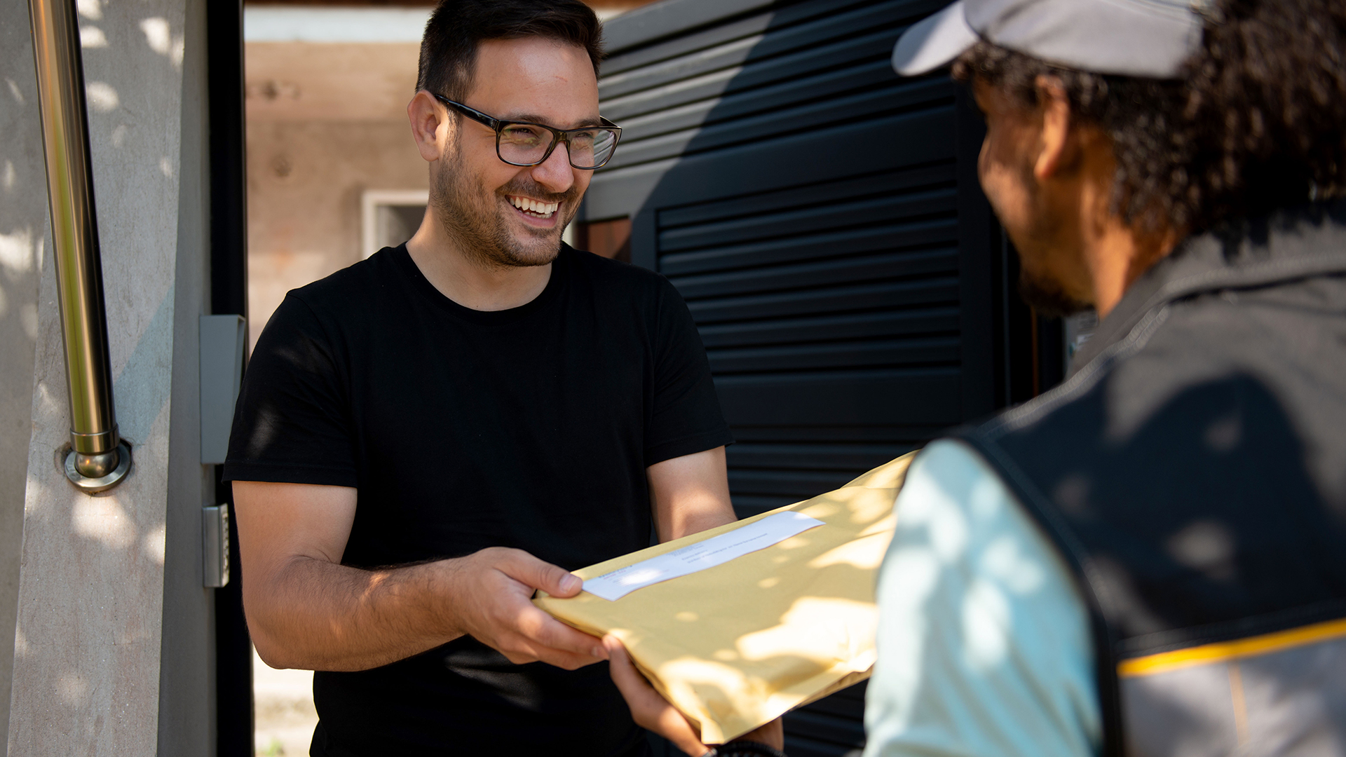 Person receiving package at home